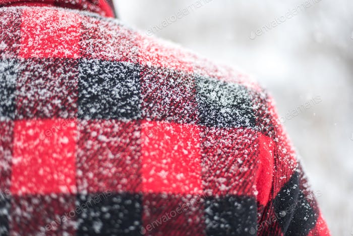 Closeup of man in red plaid jacket in the snow