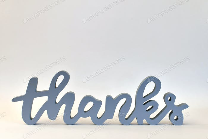 Thanks! A blue gray THANKS sign on a white background.