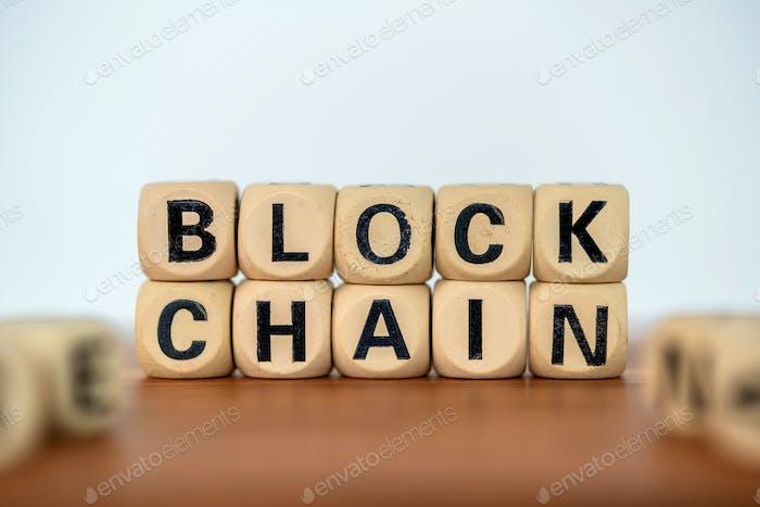 Close up word blockchain on wooden block
