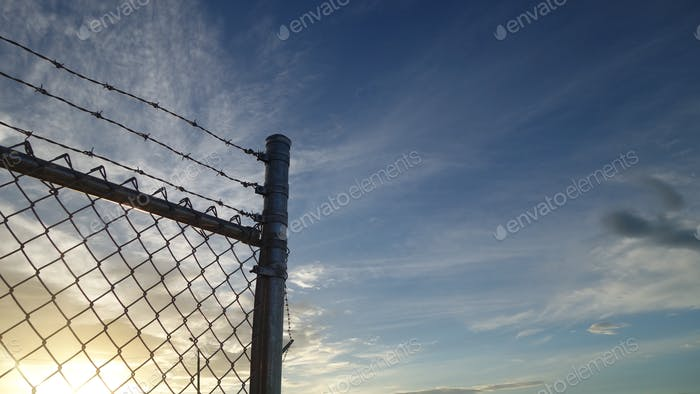Sunset Beyond The Chainlink Fence