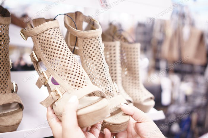 Shopping for shoes at retail store