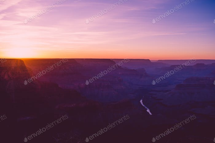 Amazing scenic overview of the sun setting over the Grand Canyon in Arizona in the early evening