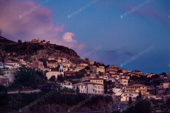 Dhermi village in Albania, Vlora district, scenic dusk view with stars.