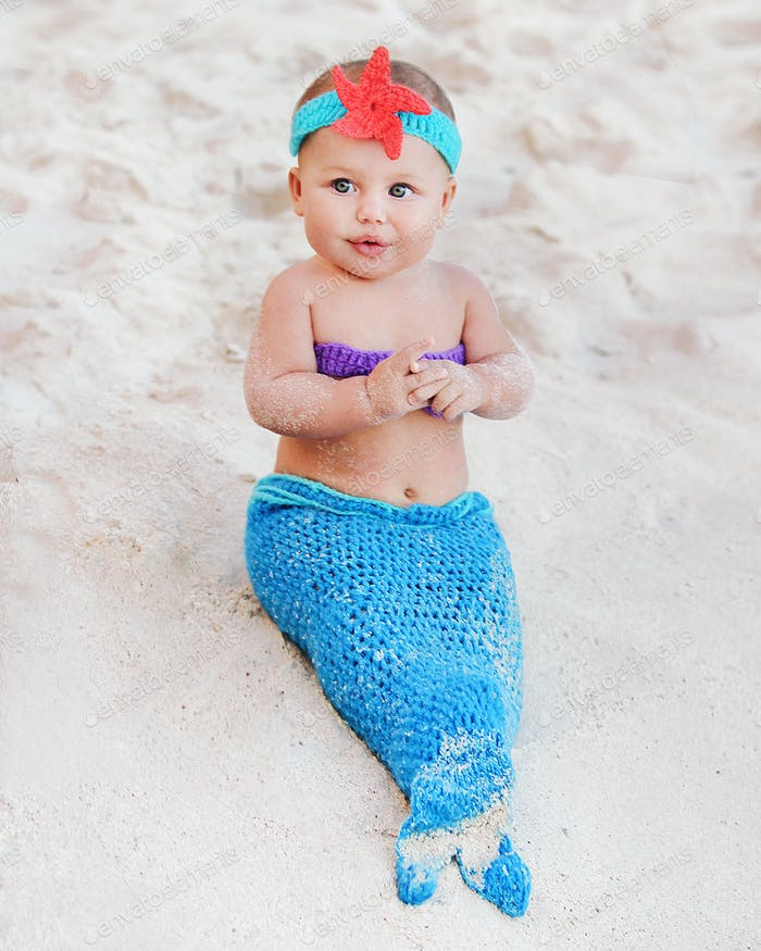 Little mermaid at the beach