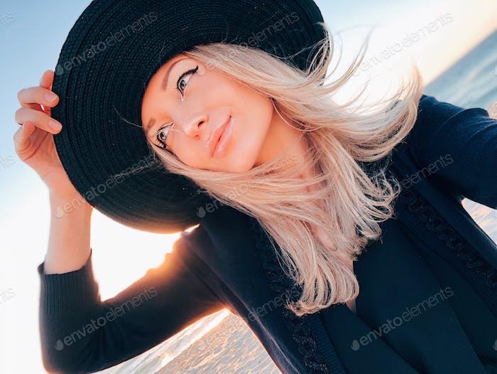Beautiful blonde girl at the beach