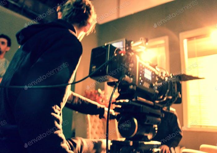 Cameraman holding a camera. Camera crew. Film camera. Digital Camera. Making film. Tv production.