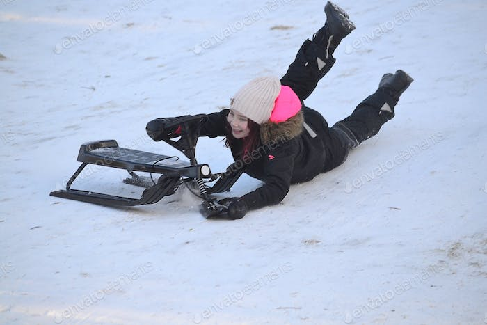 Girl crash with the sled