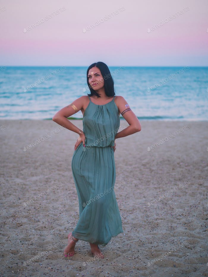 Portrait of beautiful woman with flash tattoo on beach