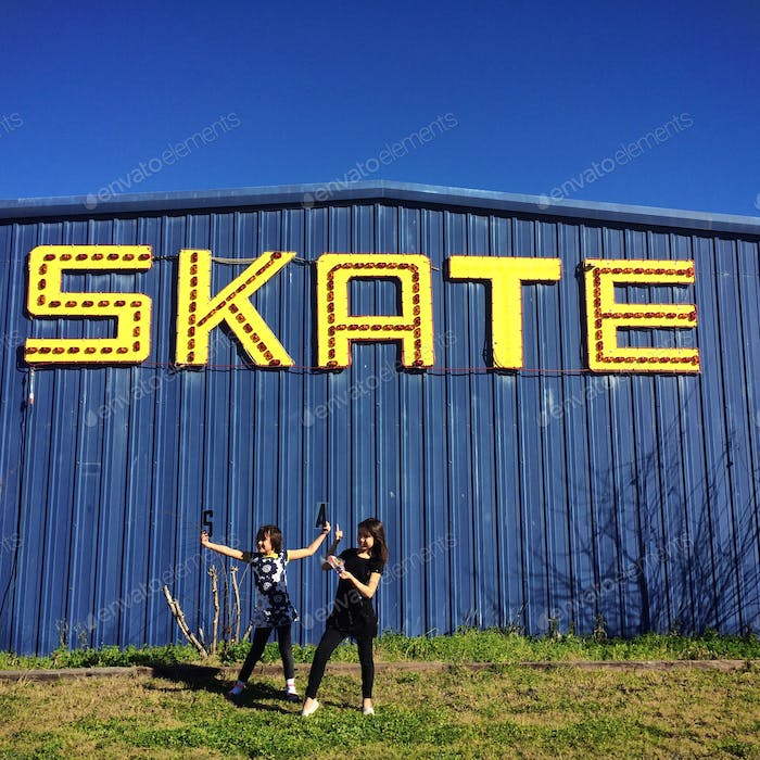 Sisters in front of skating rink