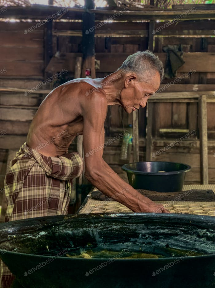 Side view of an old man working