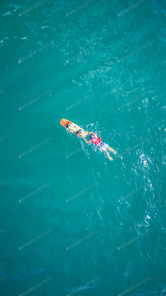 Swimmer  in water from above