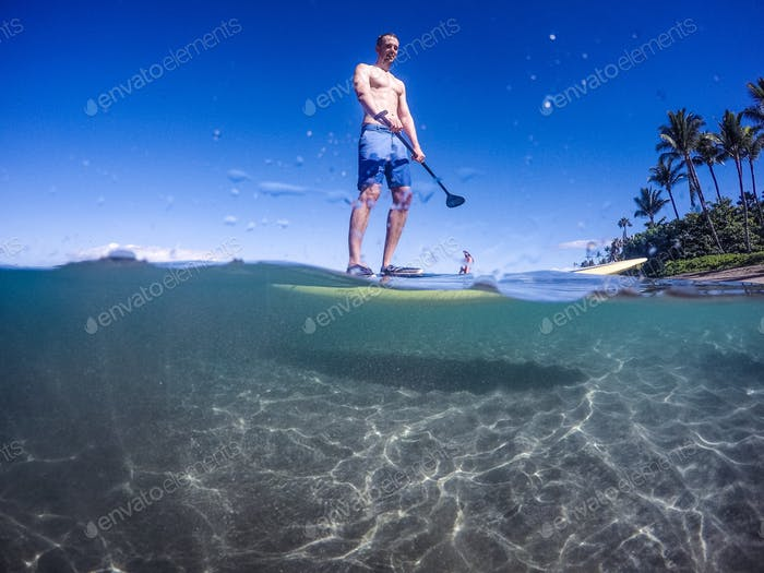 Paddle board water over under view