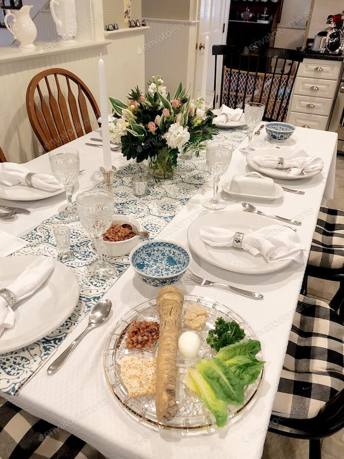 Table set for Passover Seder.