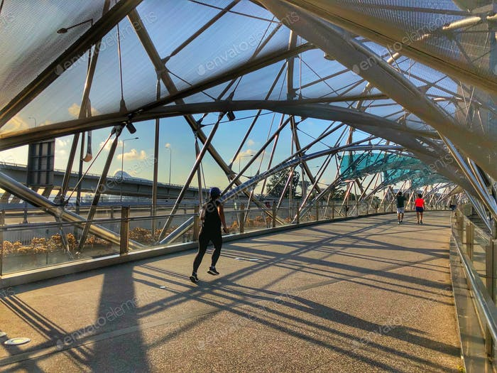 A woman running in the helix bridge around the city