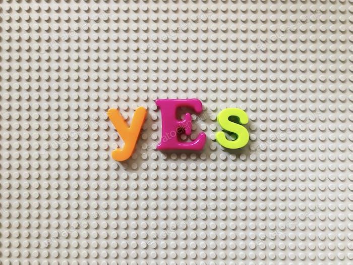 Yes. Alphabet. Alphabets. Alphabet letters. Fridge magnets. Colorful.