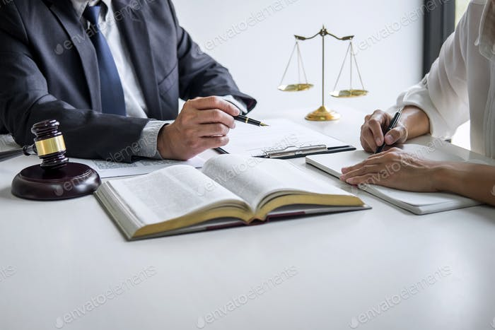 Consultation and conference of professional businesswoman and Male lawyers working and discussion