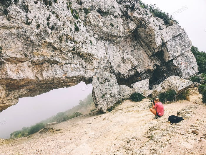Female hiker taking photos