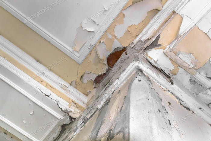 Peeling paint on an interior ceiling a result of humidity