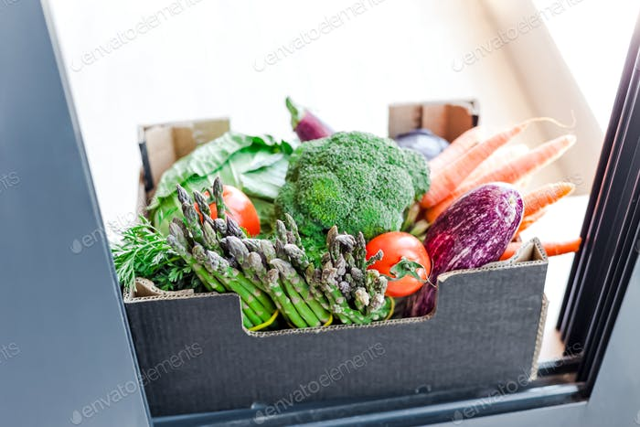 Fresh organic greens and vegetables safe contactless delivery during coronavirus Covid-19 pandemic