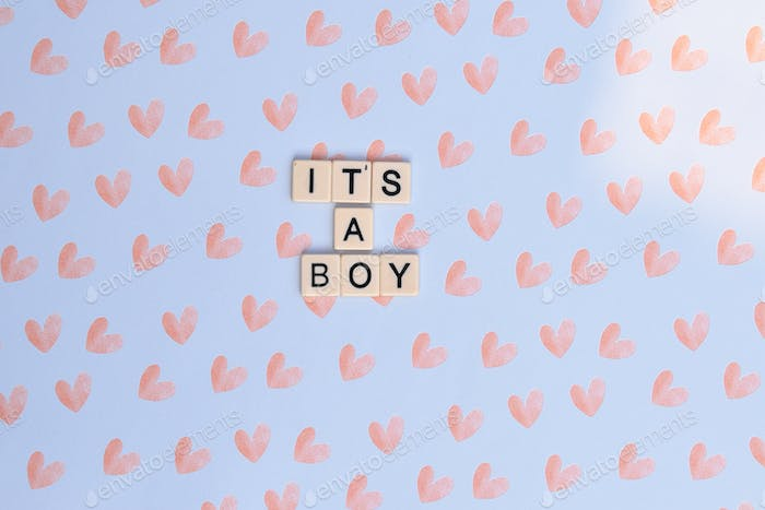 it's a boy announcement on blue background with pink hearts