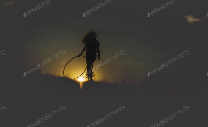 Hula hooping amidst the sunset