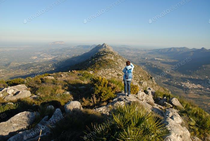 Woman hiker on a mountain trail, Cavall Verde, Alicante Prov. Spain