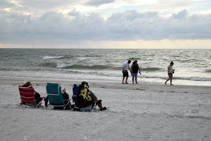 Stormy day on a Florida beach with beachgoers and sunbathers
