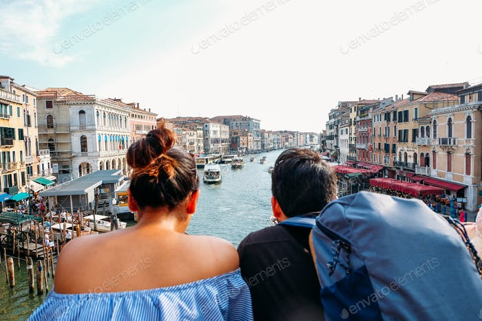 backpacking couple in looking out at landscape of venice in italy