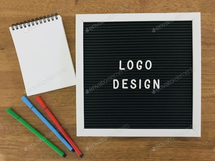 Logo Design on wooden background 100