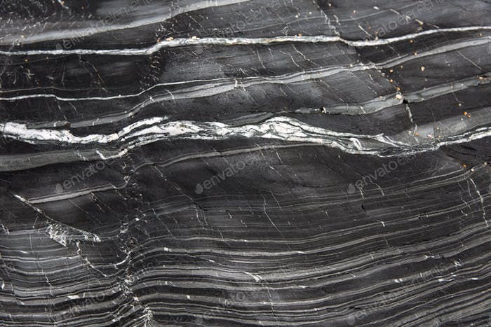 A background image of the layers in a geological rock formation of slate and marble with copy space