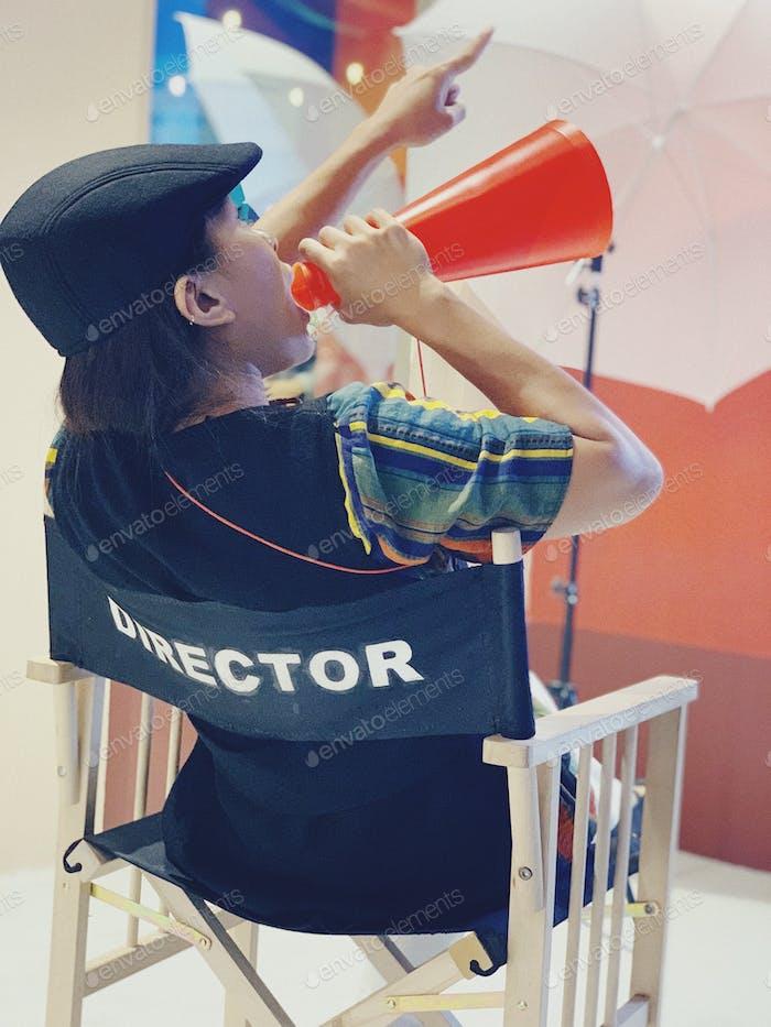 Female director, during film shoot