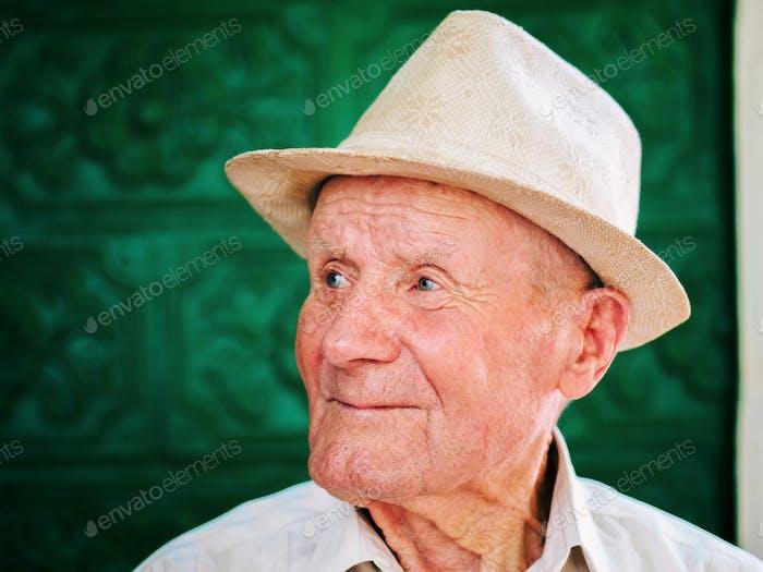 Very old pensioner grandpa in hat