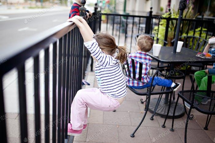 little girl at a patio restaurant