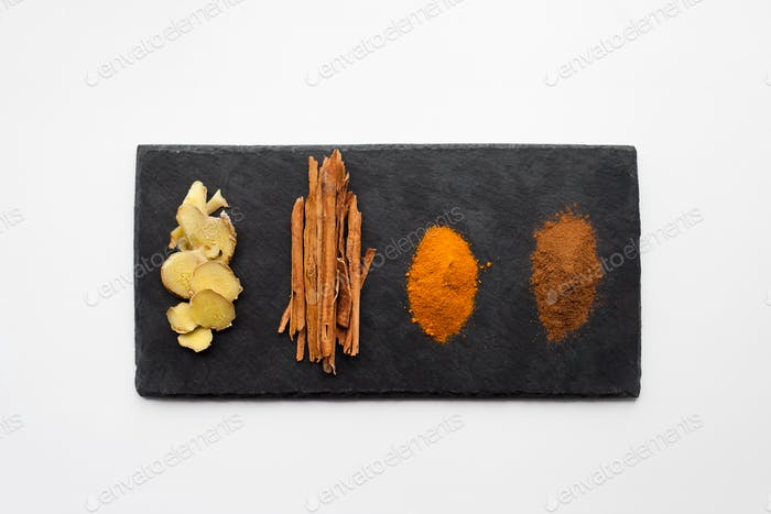 Ingredients for golden milk (turmeric milk) - alternative medicine concept, naturopathy, spice,herbs