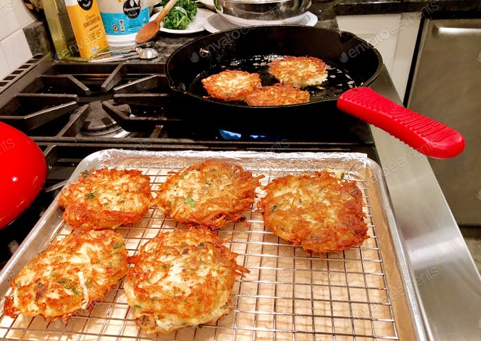 Traditional latkes (potato pancakes) made from scratch to celebrate the first night of Hanukkah.