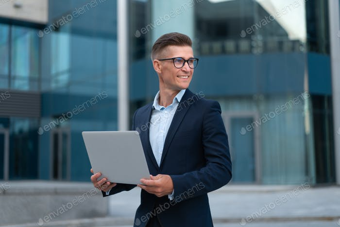 Business, Businessman outdoor with laptop. Technology