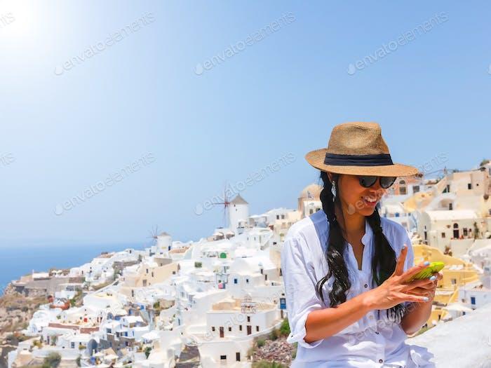 Female tourist using smartphone