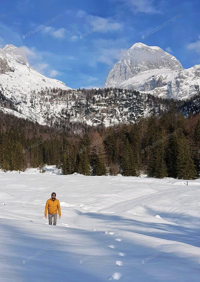 Man in yellow winter jacket wearing sunglasses