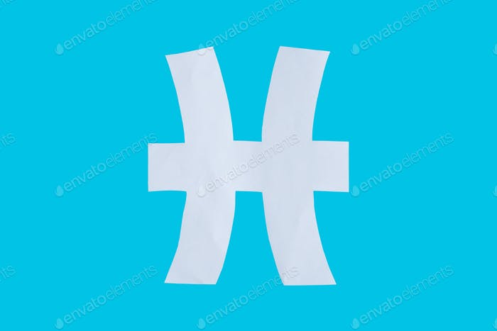 paper cut horoscope sign Pisces isolated on a blue background