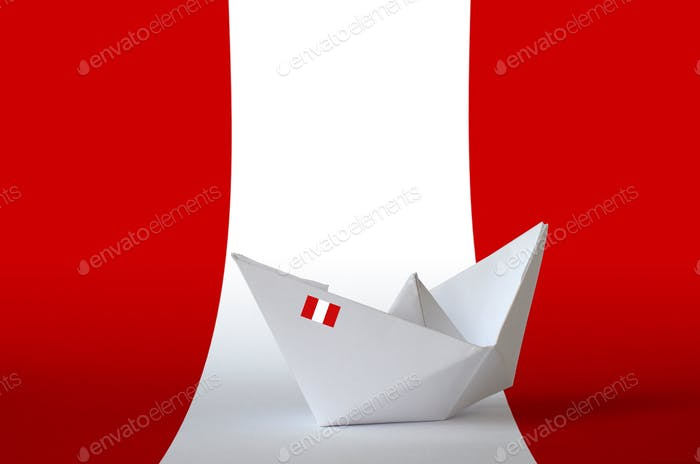 Peru flag depicted on paper origami ship closeup. Oriental handmade arts concept
