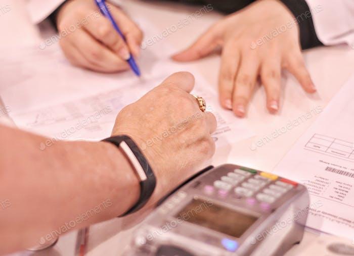 Pharmacist explains vital information regarding new medicine  prescription with customer Health Care