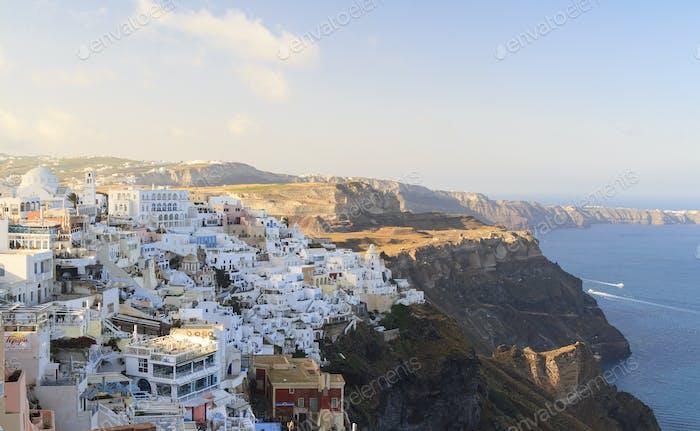 Fira town on Santorini hanging on cliffs edge. Vacation destination on Santorini, Cyclades in Greece