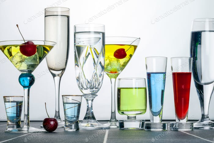 A range of alcoholic cocktails - A cocktail is an alcoholic drink with one or more spirits mixed