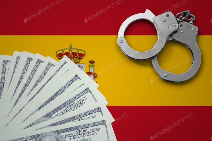 Spain flag  with handcuffs and a bundle of dollars