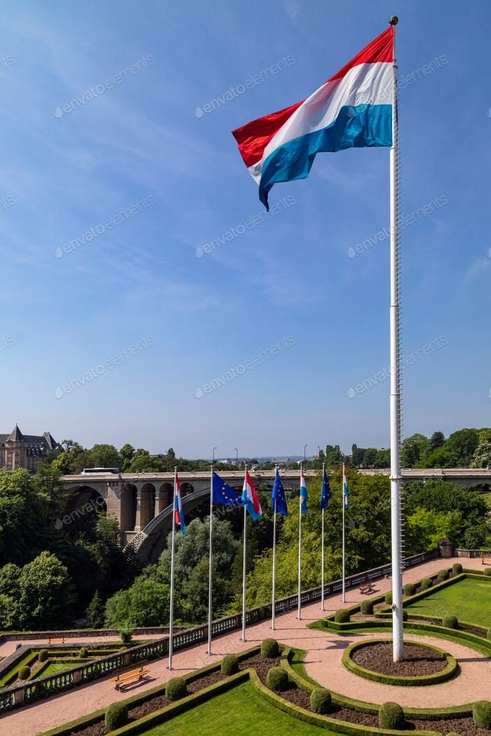 The national flag of Luxembourg flying over Parc de la Constitution in Luxembourg City in the Grand