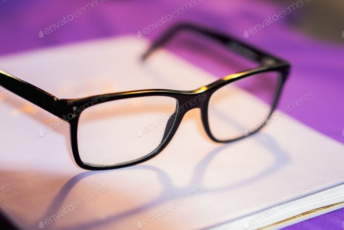 Eyeglasses on a notepad or notebook