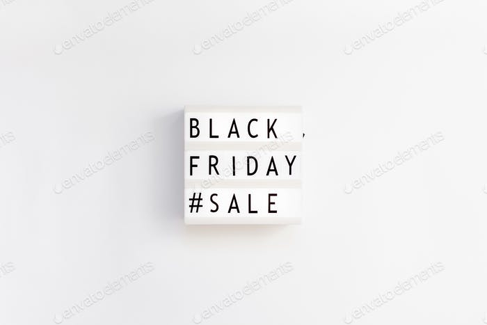 Creative Top view flat lay promotion composition Black friday sale text on lightbox white background