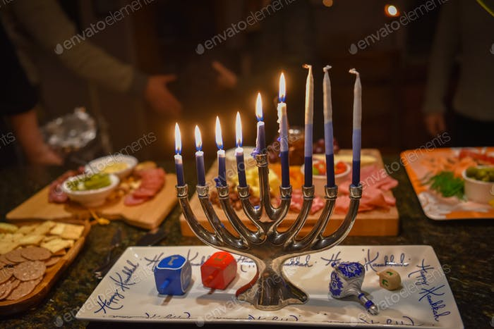 The centerpiece of the Hanukkah celebration is the menorah, a candelabra that holds nine candles.