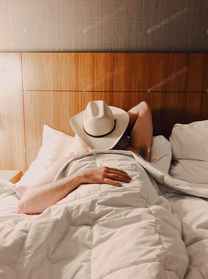 Sleeping with a cowboy hat on