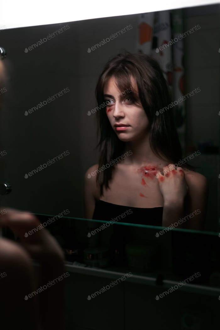 Portrait of a sad girl who has suffered physical violence.